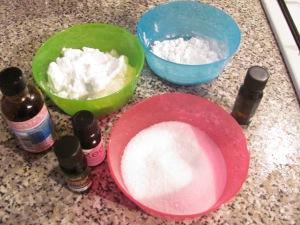 Rose water, essential oils, bicarbonate of soda, cornflour, citric acid, cosmetic colouring